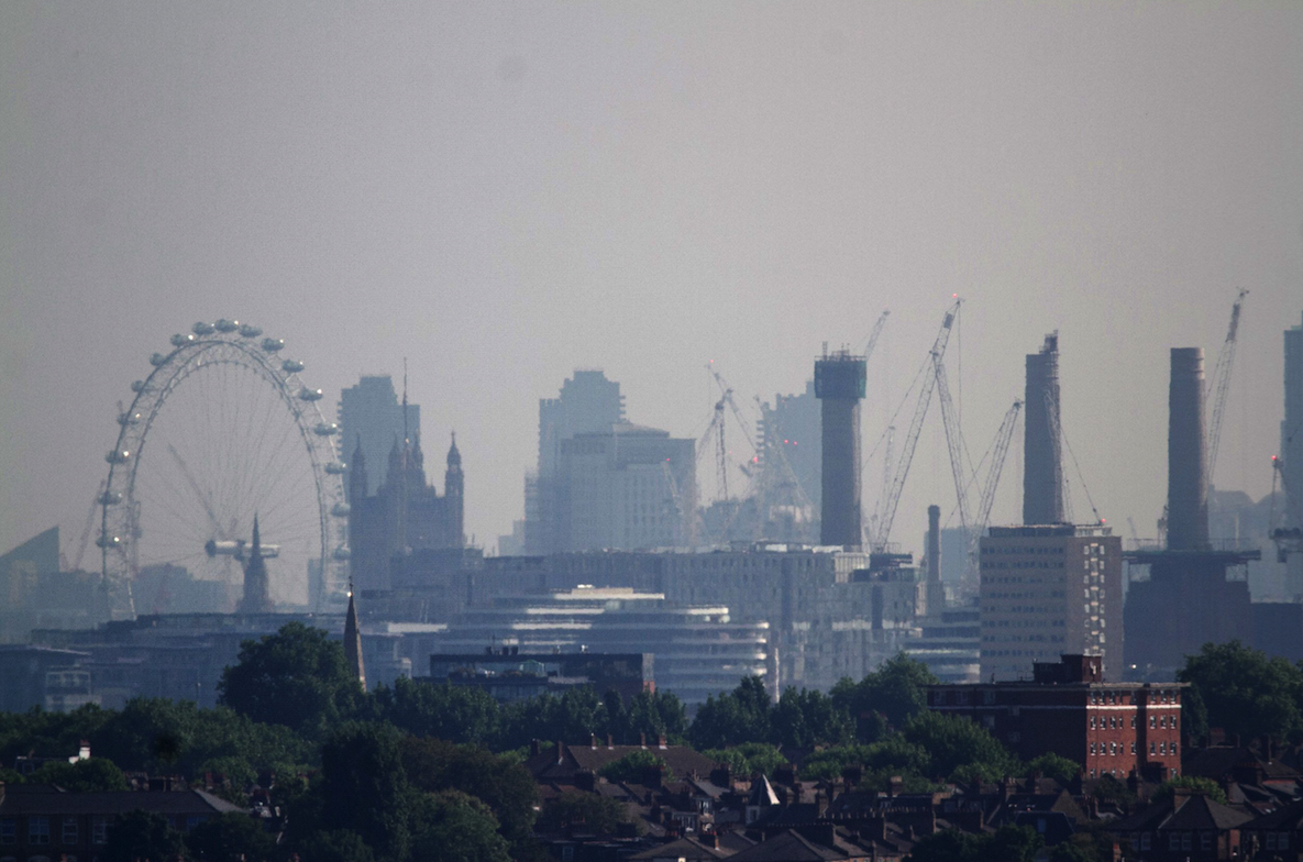 <p>This photo, taken from Wimbledon, shows the London skyline in the sun (Picture: REX Features) </p>
