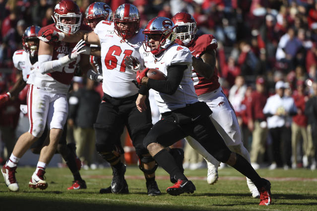 Western Kentucky quarterback Ty Storey runs the ball against Arkansas during the second half of an NCAA college football game, Saturday, Nov. 9, 2019 in Fayetteville, Ark. (AP Photo/Michael Woods)