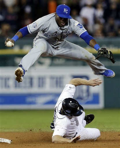 Detroit Tigers' Andy Dirks makes Kansas City Royals second baseman Irving Falu jump after tagging second base on a Detroit Tigers' Jhonny Peralta fielder's choice in the eighth inning of a baseball game in Detroit, Wednesday, Sept. 26, 2012. Peralta was safe at first base and pinch runner Don Kelly scored on the play. (AP Photo/Paul Sancya)