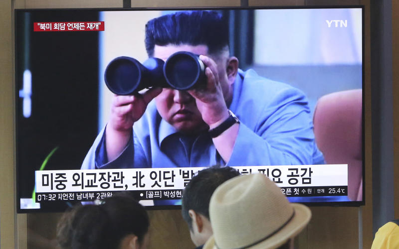 "FILE - In this Aug. 2, 2019, file photo, people watch a TV showing a file footage of North Korean leader Kim Jong Un during a news program at the Seoul Railway Station in Seoul, South Korea. North Korea on Saturday, Aug. 10, 2019, extended a recent streak of weapons display by firing projectiles twice into the sea, according to South Korea's military. The sign reads ""North Korea launches frequently."" (AP Photo/Ahn Young-joon, File)"