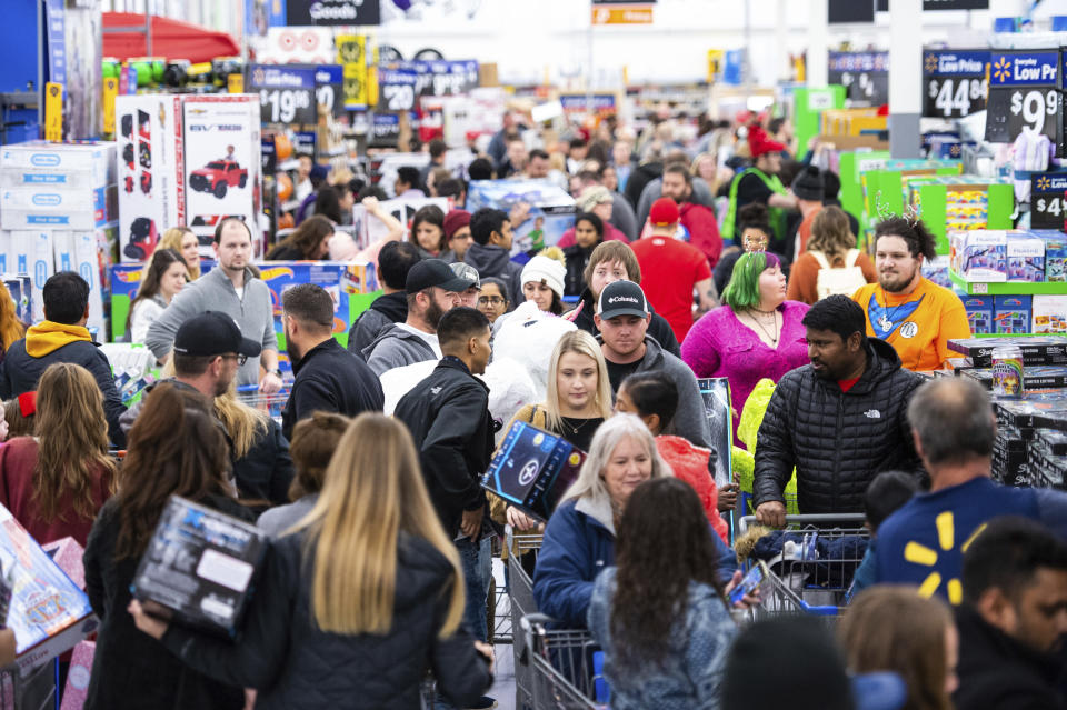 Customers stock up on electronics, toys, apparel, and home goods at Walmart's Black Friday store event, on Thursday, Nov. 28, in Bentonville, Ark. (Gunnar Rathbun/AP Images for Walmart)