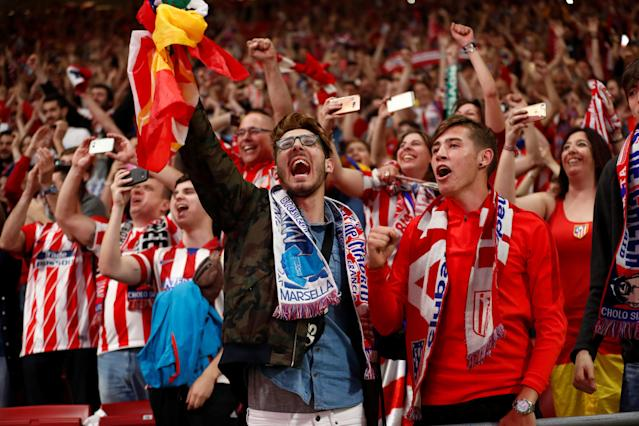 Soccer Football - Europa League Final - Atletico Madrid fans watch the final - Olympique de Marseille vs Atletico Madrid - Wanda Metropolitano, Madrid, Spain - May 16, 2018 Atletico Madrid fans celebrate winning the Europa League REUTERS/Juan Medina