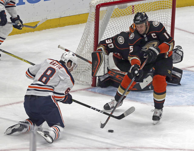 Edmonton Oilers right winger Ty Rattie (8) and Anaheim Ducks center Ryan Getzlaf (15) battle at the Ducks' goal in the first period of an NHL hockey game in Anaheim, Calif., Sunday, Feb. 25, 2018. (AP Photo/Reed Saxon)