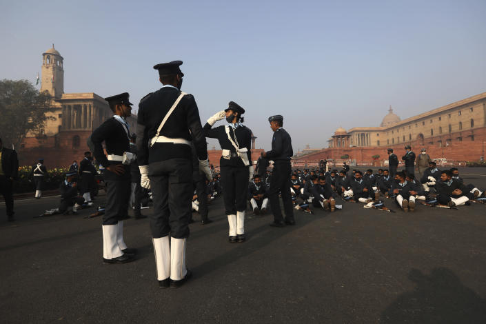 An officer of the Indian Air Force marching contingent practices her salute during rehearsals for the upcoming Republic Day parade in New Delhi, India, Thursday, Jan. 21, 2021. Republic Day marks the anniversary of the adoption of the country's constitution on Jan. 26, 1950. Thousands congregate on Rajpath, a ceremonial boulevard in New Delhi, to watch a flamboyant display of the country's military power and cultural diversity. (AP Photo/Manish Swarup)