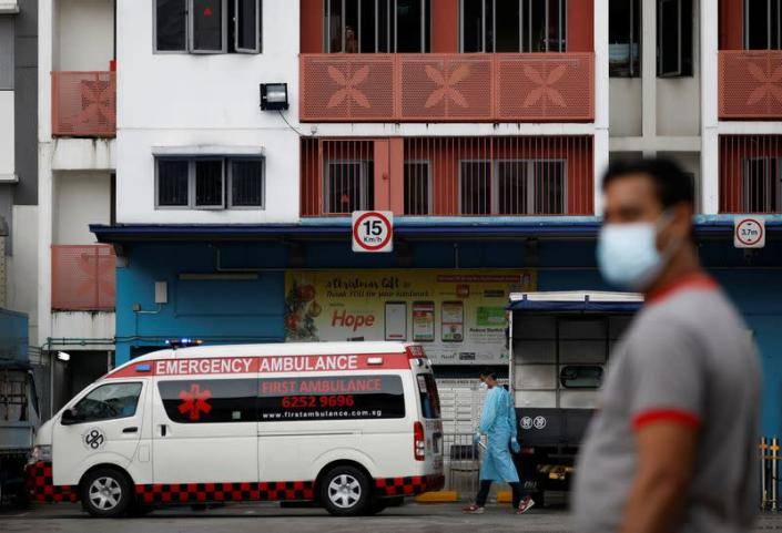 An ambulance arrives at Westlite Woodlands dormitory after workers were tested positive for the coronavirus disease (COVID-19) in Singapore