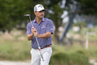Kevin Kisner reacts to a missed birdie putt on the 18th hole during the first playoff hole against Robert Streb during the final round of the RSM Classic golf tournament, Sunday, Nov. 22, 2020, in St. Simons Island, Ga. (AP Photo/Stephen B. Morton)