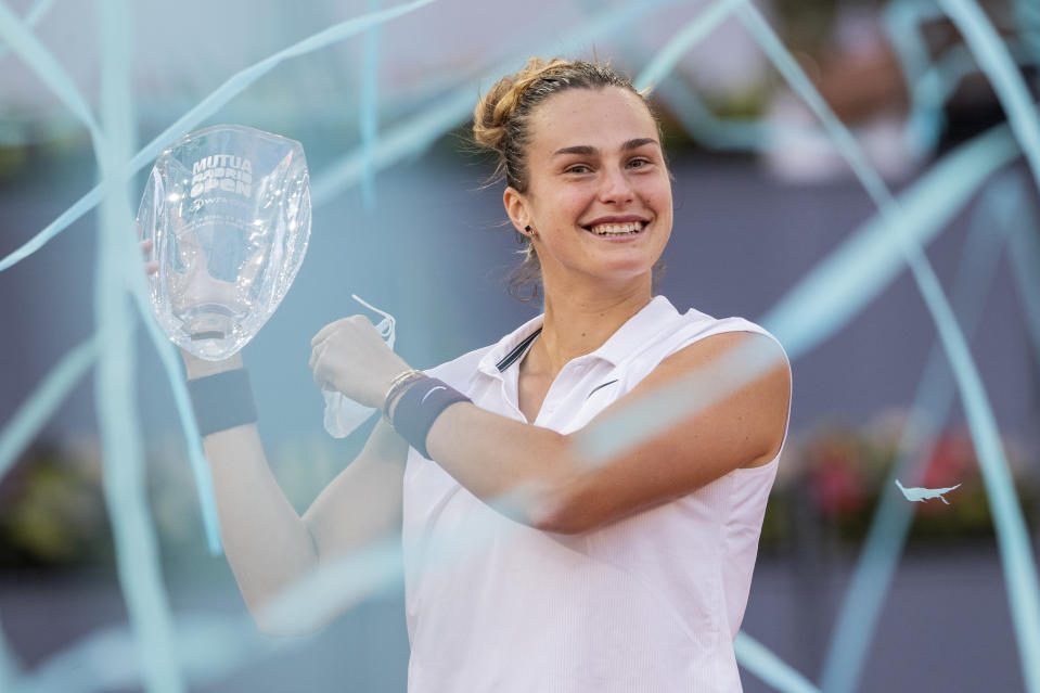 Aryna Sabalenka of Belarus holds a trophy after winning the women's final match against Australia's Ashleigh Barty at the Mutua Madrid Open tennis tournament in Madrid, Spain, Saturday, May 8, 2021. (AP Photo/Bernat Armangue)