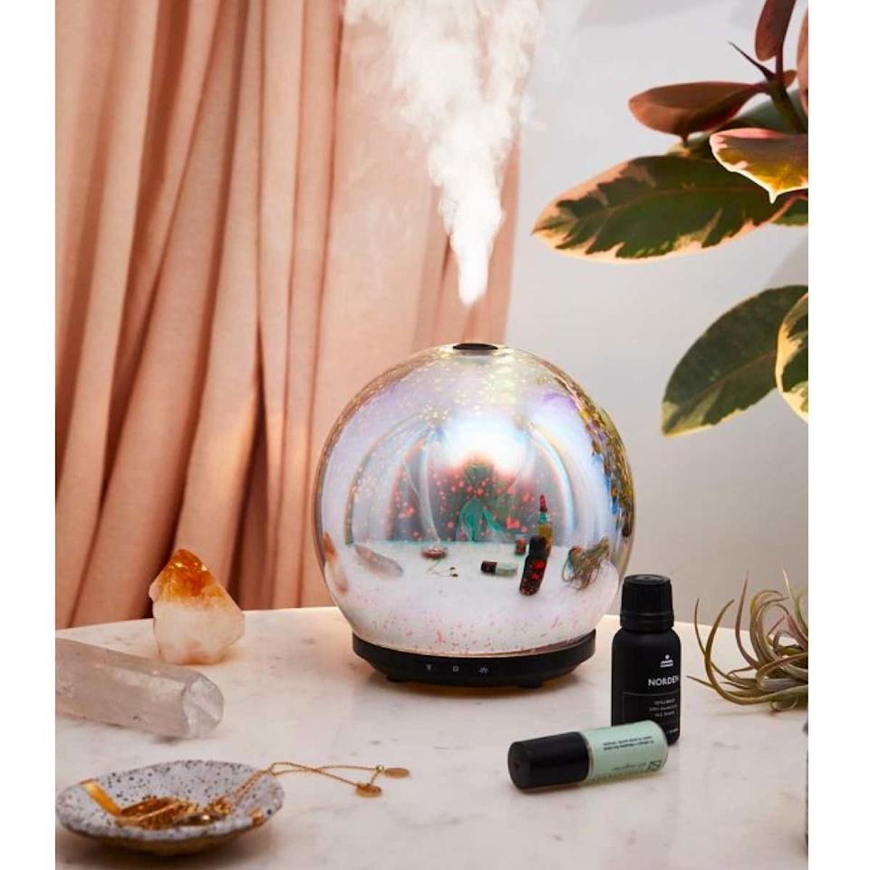 """Set off the good vibes in your witchy girlfriend's home with this mesmerizing oil diffuser that resembles a crystal ball. $65, Urban Outfitters. <a href=""""https://www.urbanoutfitters.com/shop/3d-led-gala-essential-oil-diffuser"""">Get it now!</a>"""