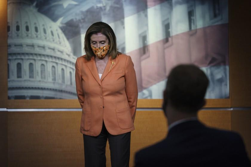 Speaker of the House Nancy Pelosi, D-Calif., meets with reporters at the Capitol in Washington, Thursday, Oct. 8, 2020.
