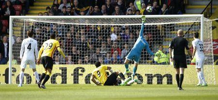 Britain Soccer Football - Watford v Swansea City - Premier League - Vicarage Road - 15/4/17 Watford's Troy Deeney has shot saved by Swansea City's Lukasz Fabianski Action Images via Reuters / Andrew Couldridge Livepic
