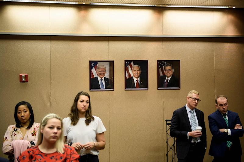 People listen while US Attorney General William Barr holds a press conference about the release of the Mueller Report at the Department of Justice April 18, 2019, in Washington, DC. | Brendan Smialowski—AFP/Getty Images
