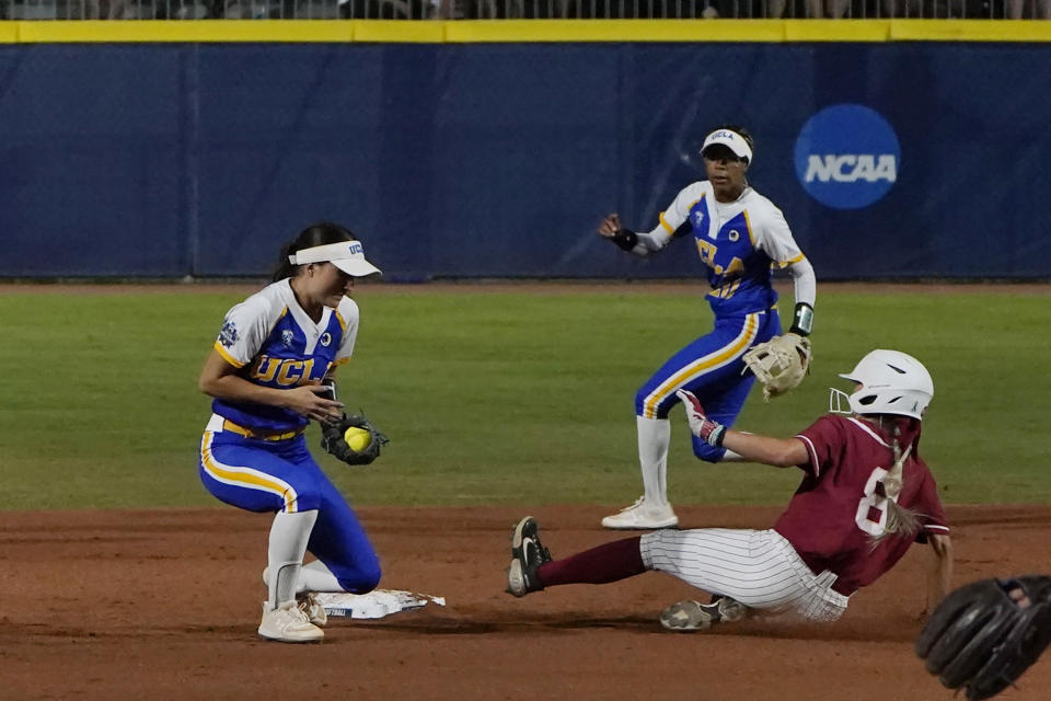 Alabama's KB Sides (8) steals second base as UCLA's Briana Perez, left, takes the throw during the first inning of an NCAA Women's College World Series softball game Friday, June 4, 2021, in Oklahoma City. (AP Photo/Sue Ogrocki)
