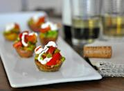 """<p>These hearty bites are savory and flavorful, all in one. The potatoes are roasted until they're browned and a little crunchy, then topped with fresh salsa and a dollop of a sour cream. This recipe makes 24 bites, so trim it down and make four to six if you're serving two people.</p> <p><strong>Get the recipe:</strong> <a href=""""https://www.popsugar.com/food/Mini-Potatoes-Tomato-Avocado-Salsa-Recipe-17194788"""" class=""""link rapid-noclick-resp"""" rel=""""nofollow noopener"""" target=""""_blank"""" data-ylk=""""slk:red potatoes stuffed with tomato avocado salsa"""">red potatoes stuffed with tomato avocado salsa</a></p>"""