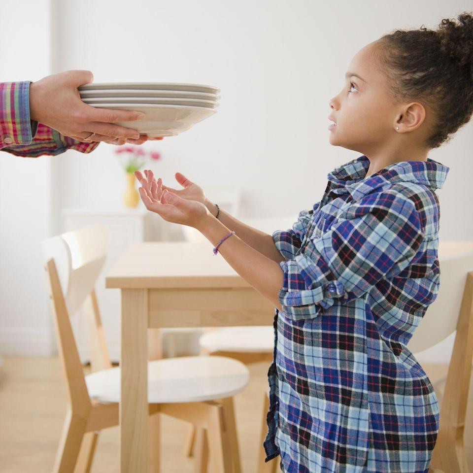 "<p>Get the little ones involved in the preparations by having them <a href=""https://www.goodhousekeeping.com/holidays/thanksgiving-ideas/g143/bold-thanksgiving-place-settings/"" rel=""nofollow noopener"" target=""_blank"" data-ylk=""slk:set the table"" class=""link rapid-noclick-resp"">set the table</a> for dinner while the adults are busy finishing up the food. It's a triple whammy: They'll be proud that they could contribute to the festivities, learn the importance of chipping in, and stay out of trouble while you're distracted by the stove. </p>"