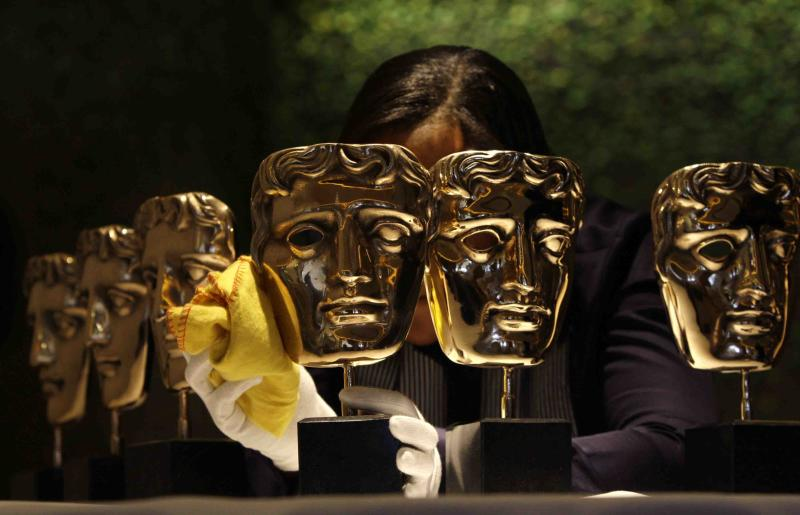British Academy Film & Television Awards, BAFTA, worker Hope polishes a BAFTA mask at the Dorchester Hotel in London, Saturday, Feb. 7, 2009, in preparation for the BAFTA awards ceremony to be held on Sunday. Hollywood stars Brad Pitt, Angelina Jolie, Penelope Cruz, Mickey Rourke and Meryl Streep are among the nominees who will grace the red carpet at Sunday's BAFTA awards. (AP Photo/Joel Ryan)