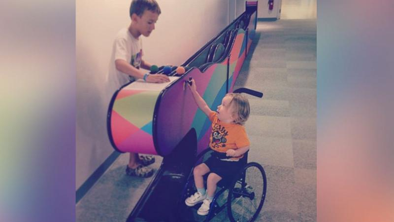 Florida Mom Searches for Mystery Child in Heartwarming Photo With Her Disabled Son
