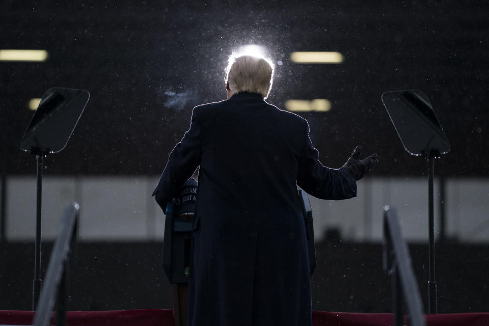 President Donald Trump speaks during a campaign rally at Capital Region International Airport, Tuesday, Oct. 27, 2020, in Lansing, Mich. (AP Photo/Evan Vucci)
