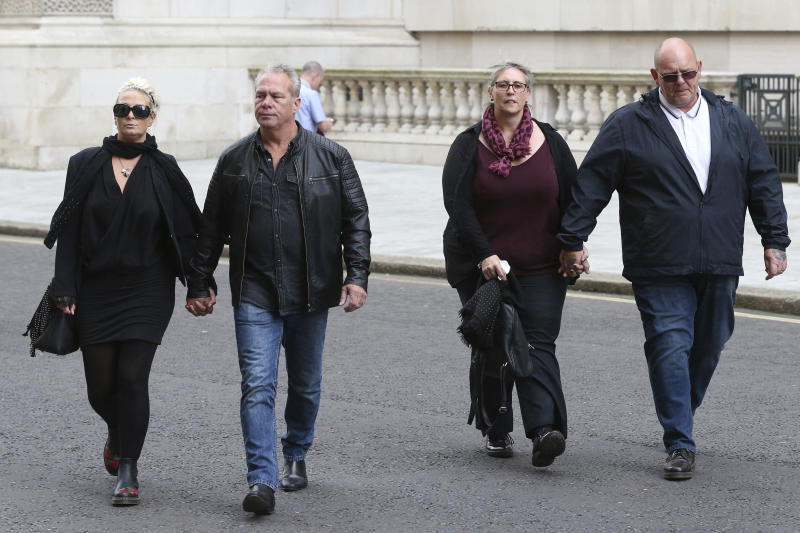 The family Harry Dunn, mother Charlotte Charles, left, and father Tim Dunn, right, arrive with their partners at the Foreign and Commonwealth Office in London, where they are meeting British Foreign Secretary Dominic Raab, Wednesday Oct. 9, 2019.  19-year old Harry Dunn was killed in a road accident Aug. 27, involving an American diplomat's wife who left the country under Diplomatic Immunity after reportedly becoming a suspect in the fatal crash. (Jonathan Brady/PA via AP)