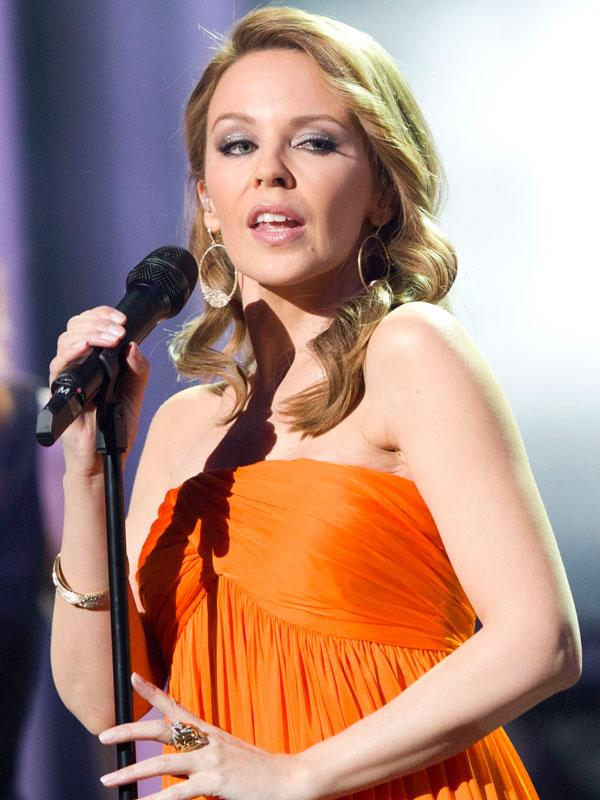 """<b>Kylie Minogue</b><br><br>Aussie pop sensation Kylie Minogue started <a target=""""_blank"""" href=""""https://ec.yimg.com/ec?url=http%3a%2f%2fwww.dailymail.co.uk%2ffemail%2farticle-2059226%2fKylie-Minogue-botox-rumours-Her-face-raising-eyebrows.html%23axzz2KZtRTbNW%26quot%3b%26gt%3braising&t=1506359497&sig=yGalbSa6s7KCypRP9q.ukg--~D a few eyebrows</a> when she was photographed with what seemed like an elevated eyebrow and younger taut-er skin. In 2009, she finally admitted to have used Botox, claiming she wanted to look """"her best"""".<br><br>But younger, wrinkle-free skin has its own problems. In this recent photograph, we wonder if she can move her facial muscles at all."""