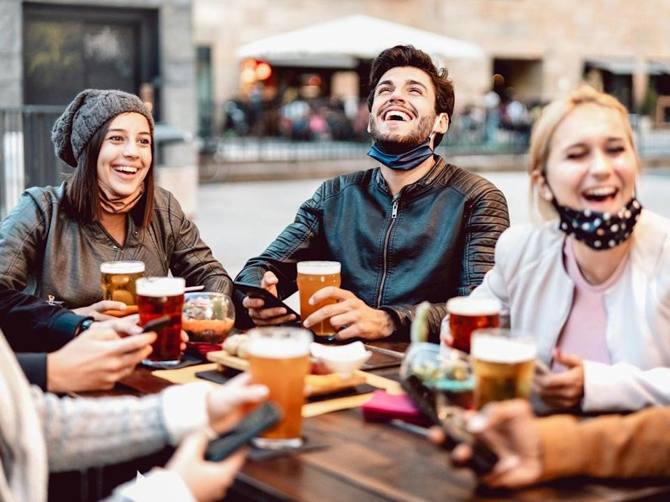 Managing a social life post-lockdown can feel daunting, but there are ways to ease yourself back into it and enjoy time spent with other people again (Getty Images/iStockphoto)
