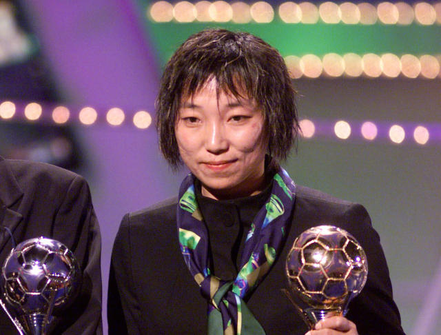 FILE - In this Jan. 24, 2000, file photo, China's Sun Wen, winner of the Golden Ball FIFA Women's World Cup USA 99, stands during the FIFA world player of 1999 gala at the Palais des Congres in downtown Brussels. Former FIFA female player of the year Sun has been elected a vice president of the Chinese Football Association as China seeks to revamp its lagging national program. (AP Photo/Yves Logghe, File)