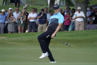 Jordan Spieth reacts as he makes an eagle putt on the 18th green during the first round of the AT&T Byron Nelson golf tournament, Thursday, May 13, 2021, in McKinney, Texas. (AP Photo/Tony Gutierrez)