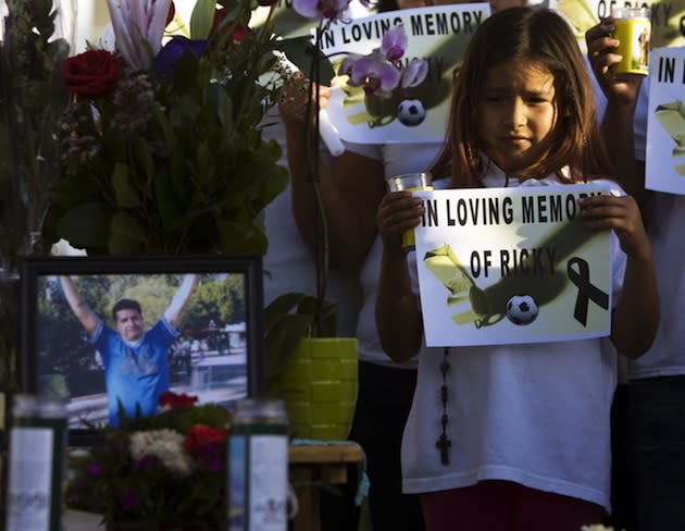 Family and friends mourn Ricardo Portillo at his funeral Wednesday — Associated Press