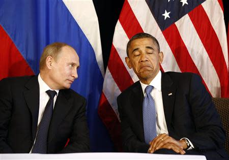 U.S. President Barack Obama (R) meets with Russia's President Vladimir Putin in Los Cabos, Mexico, in this June 18, 2012 file photo. REUTERS/Jason Reed/Files