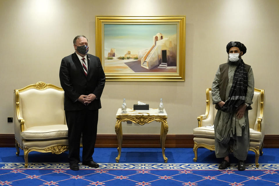 FILE - In this Nov. 21, 2020 file photo, Secretary of State Mike Pompeo meets with Mullah Abdul Ghani Baradar, head of the Taliban's peace negotiation team, amid talks between the Taliban and the Afghan government, in Doha, Qatar. Baradar, the Taliban's top political leader, who made a triumphal return to Afghanistan this week, battled the U.S. and its allies for decades but then signed a landmark peace agreement with the Trump administration. Baradar is now expected to play a key role in negotiations between the Taliban and officials from the Afghan government that the insurgents deposed in their blitz across the country. (AP Photo/Patrick Semansky, Pool, File)