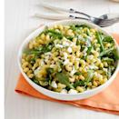 """<p>Need to feed a large crowd? Combine macaroni with green beans, feta cheese, and peppery arugula for a hearty, easy-to-make pasta salad.</p><p><em><a href=""""https://www.womansday.com/food-recipes/food-drinks/recipes/a12275/lemony-pasta-salad-green-beans-arugula-recipe-wdy0513/"""" rel=""""nofollow noopener"""" target=""""_blank"""" data-ylk=""""slk:Get the Lemony Pasta Salad With Green Beans and Arugula recipe."""" class=""""link rapid-noclick-resp"""">Get the Lemony Pasta Salad With Green Beans and Arugula recipe.</a> </em></p>"""