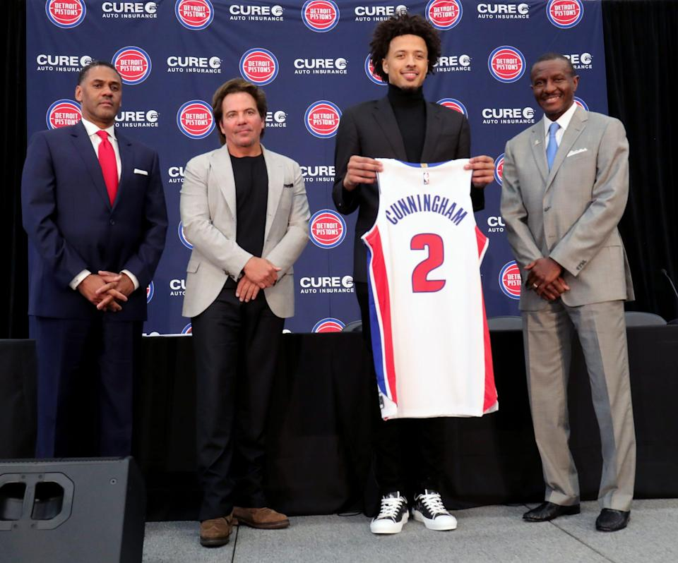 Pistons GM Troy Weaver, owner Tom Gores, first-round pick Cade Cunningham and head coach Dwane Casey pose after the news conference on Friday, July 30, 2021, at the team's practice facility in Detroit.
