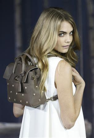 Cara Delevigne presents the Cara Delevigne Collection by Mulberry during London Fashion Week February 16, 2014. REUTERS/Olivia Harris