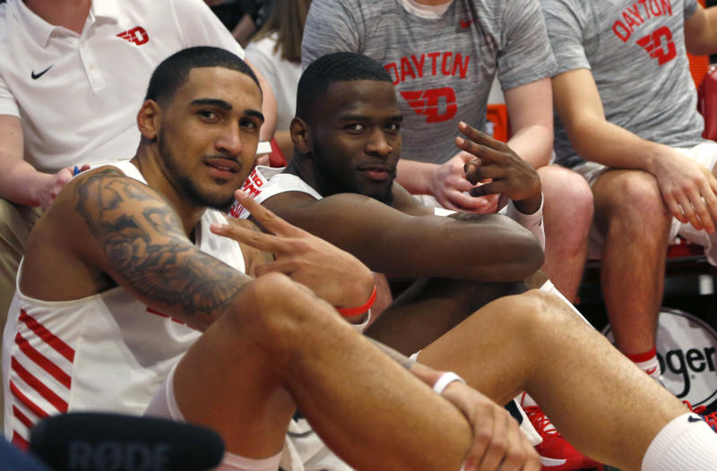 Dayton Flyers forward Obi Toppin (left) and guard Jalen Crutcher (10) react late in the second half of a game against Rhode Island. (David Kohl/USAT)