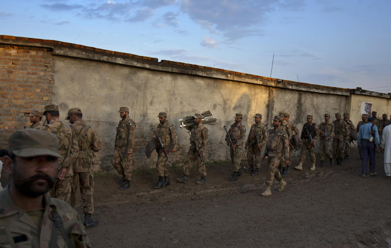 Fresh Pakistan army troops arrive to take part in rescue operation at the site of Boeing 737 passenger plane crash on the outskirts of Islamabad, Pakistan, Saturday, April 21, 2012. Pakistan blocked the head of an airline whose jet crashed near the capital from leaving the country as it began an investigation Saturday into the country's second major air disaster in less then two years. (AP Photo/Anjum Naveed)