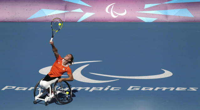 -FILE- In this Friday, Sept. 7, 2012, file image Esther Vergeer of the Netherlands plays a return to Aniek Van Koot during the gold medal match during the women's wheelchair tennis final at the 2012 Paralympics games.Esther Vergeer, the retired Dutch wheelchair tennis star who went on a 470-match winning streak during her record-breaking career, has been diagnosed with breast cancer. (AP Photo/Alastair Grant, File)