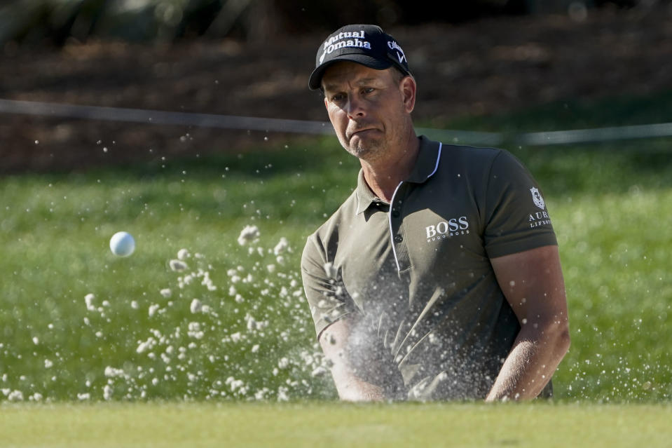 Henrik Stenson of Sweden, watches his bunker shot on the ninth hole during the first round of the The Players Championship golf tournament Thursday, March 11, 2021, in Ponte Vedra Beach, Fla. (AP Photo/John Raoux)