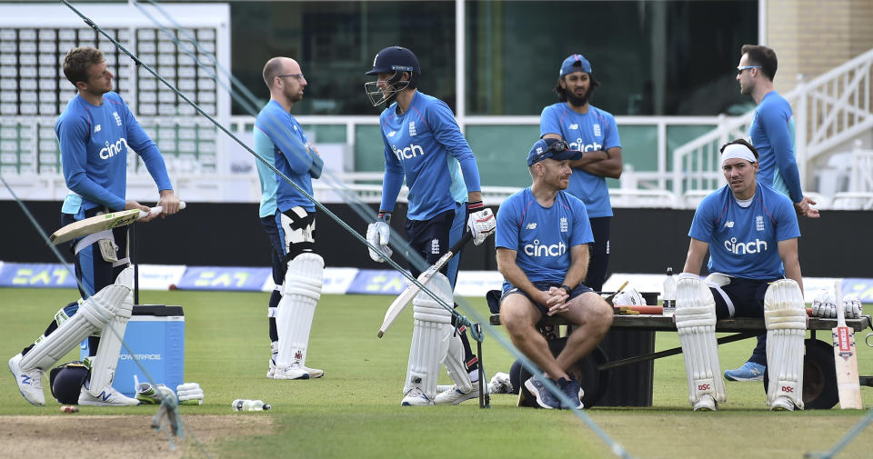 England's Jos Buttler, left, Jack Leach, 2nd left, captain Joe Root, 3rd left, and Rory Burns, far right, during nets practice prior to the first Test Match between England and India at Trent Bridge cricket ground in Nottingham, England, Tuesday, Aug. 3, 2021. (AP Photo/Rui Vieira)