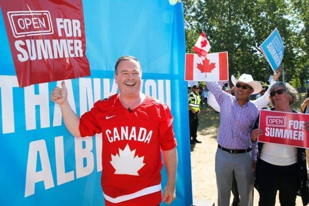 Alberta Premier Jason Kenney celebrates the lifting of public health restrictions by taking part in Canada Day celebrations in Calgary on July 1. (Larry MacDougal/The Canadian Press - image credit)