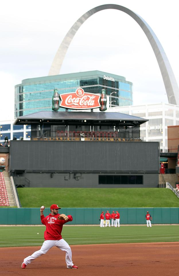ST LOUIS, MO - OCTOBER 20:  The St. Louis Cardinals practice on the field prior to Game Two of the MLB World Series against the Texas Rangers at Busch Stadium on October 20, 2011 in St Louis, Missouri.  (Photo by Jamie Squire/Getty Images)