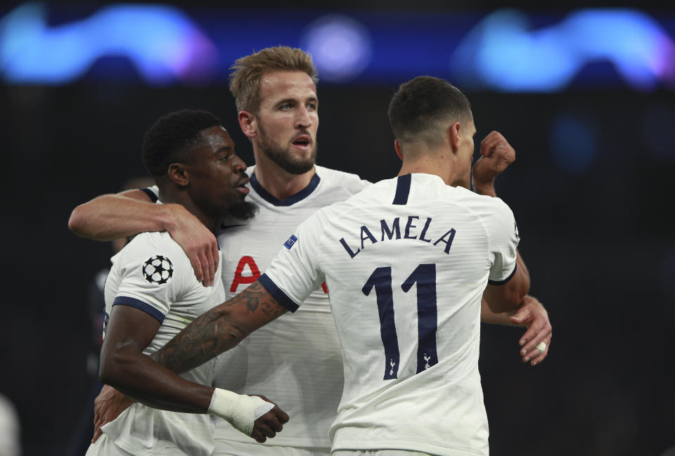 Tottenham's Erik Lamela, right, celebrates after scoring his side's fourth goal during the Champions League, group B, soccer match between Tottenham and Red Star Belgrade, at the Tottenham Hotspur stadium in London, Tuesday, Oct. 22, 2019. (AP Photo/Ian Walton)