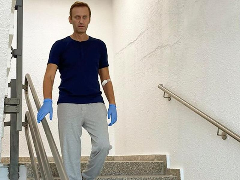 Russian opposition politician Alexei Navalny goes down the stairs at Charite hospital in Berlin (via REUTERS)