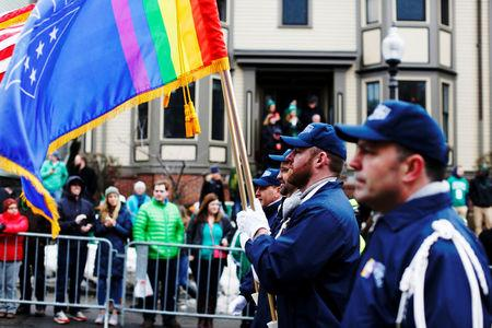 FILE PHOTO - The color guard for LGBT veterans group OutVets marches down Broadway during the St. Patrick's Day Parade in South Boston