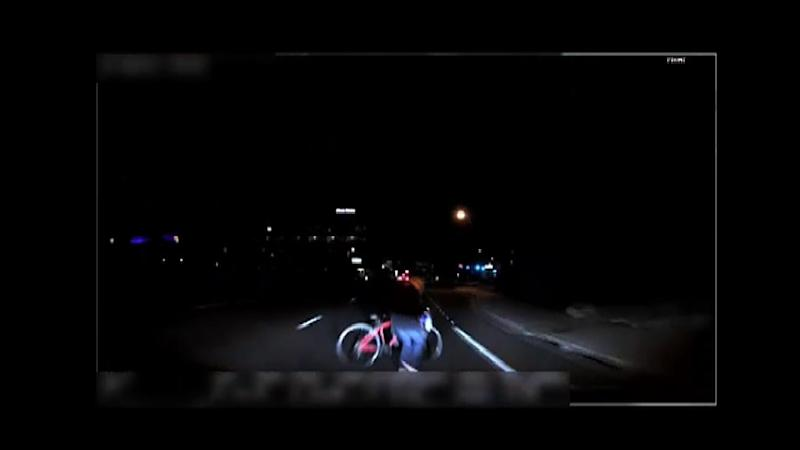 This video grab made from dashcam footage released by the Tempe Police Department shows the moment before the collision of Uber's self-driving vehicle and a pedestrian