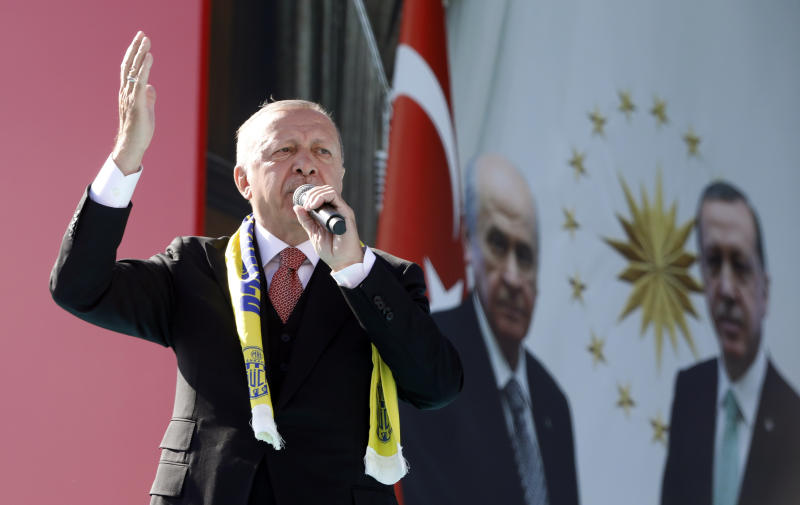 Turkey's President Recep Tayyip Erdogan addresses the supporters of his ruling Justice and Development Party, AKP, during a rally in Ankara, Turkey, Saturday, March 23, 2019, ahead of local elections scheduled for March 31, 2019. (AP Photo/Burhan Ozbilici)