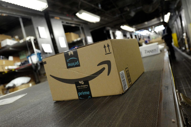FILE- In this May 9, 2017, file photo, a package from Amazon Prime moves on a conveyor belt at a UPS facility in New York. Amazon's Prime Day starts July 16, 2018, and will be six hours longer than last year's and will launch new products. (AP Photo/Mark Lennihan, File)