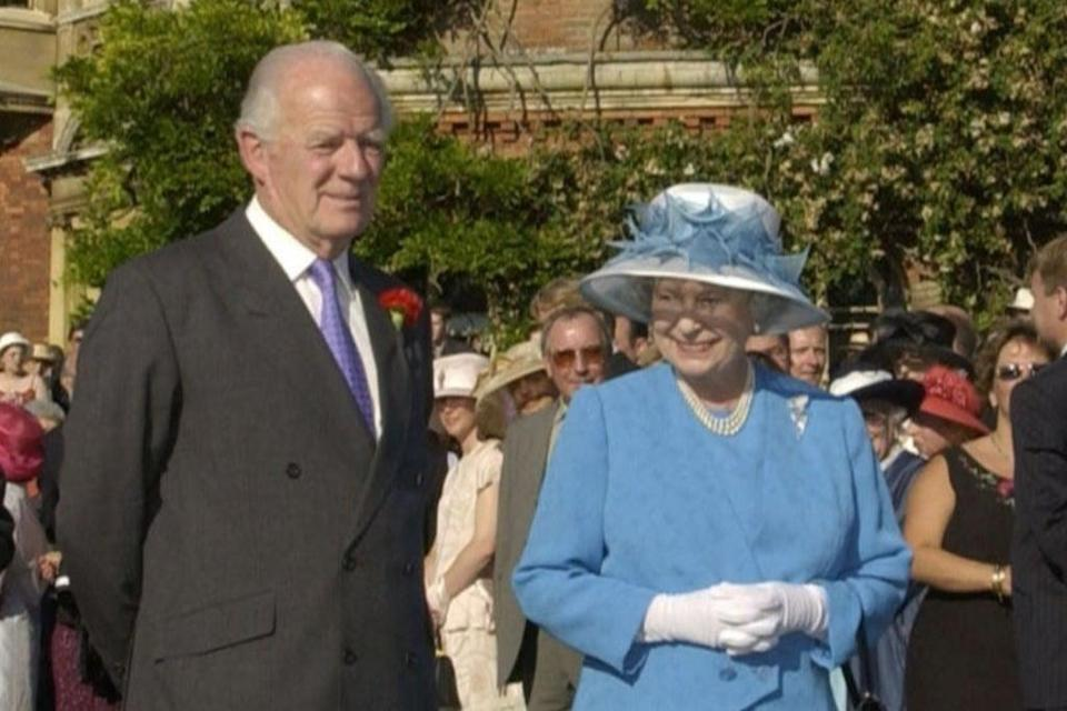 The Queen with  Sir Timothy Colman at a Garden Party for East Anglia at Sandringham House in 2002 (PA)