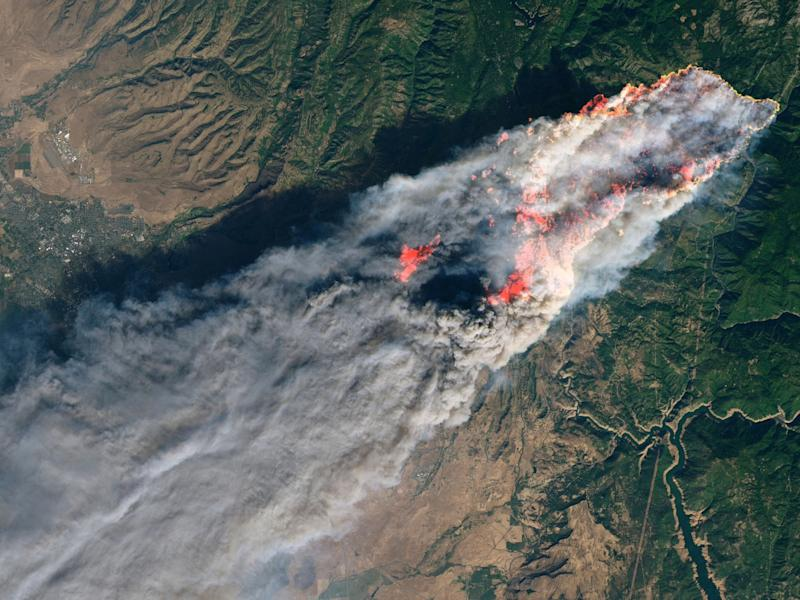 Enhanced satellite image provided by Nasa's Earth Observatory shows the Camp Fire in Paradise, California, on Thursday, 8 November: Nasa via AP