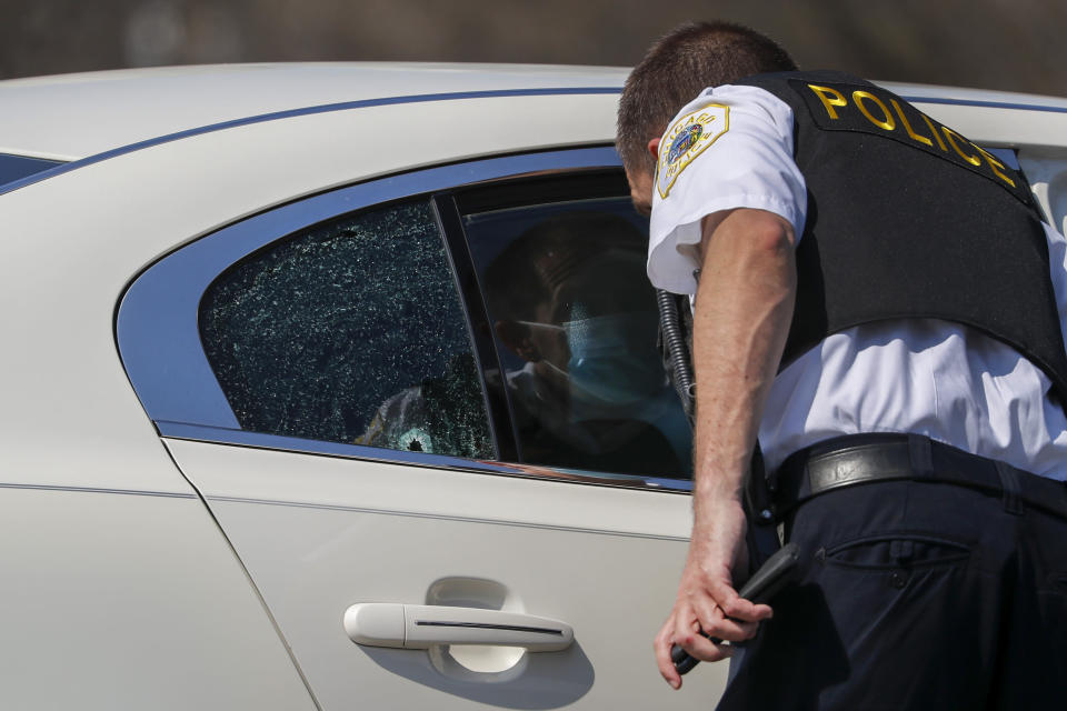 Chicago police investigate the scene of a shooting where a 2-year-old boy was shot in the head while he was traveling inside a car near Grant Park, Tuesday, April 6, 2021. (Jose M. Osorio/Chicago Tribune via AP)