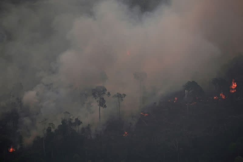 FILE PHOTO: Smoke billows during a fire in an area of the Amazon rainforest near Porto Velho, Rondonia