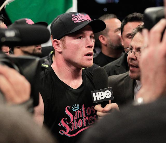 "Saul ""Canelo"" Alvarez is interviewed after knocking out James Kirkland in the third round of a 154-pound fight on Saturday, May 9, 2015, in Houston. (AP Photo/Bob Levey)"